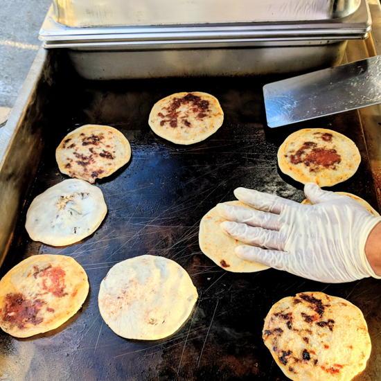 Big Grandma's Kitchen - Chef Lima grilling pupusas (Foodzooka)