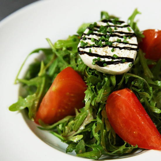Bistro de la Gare (courtesy) - Heirloom tomatoes on arugula with burrata cheese