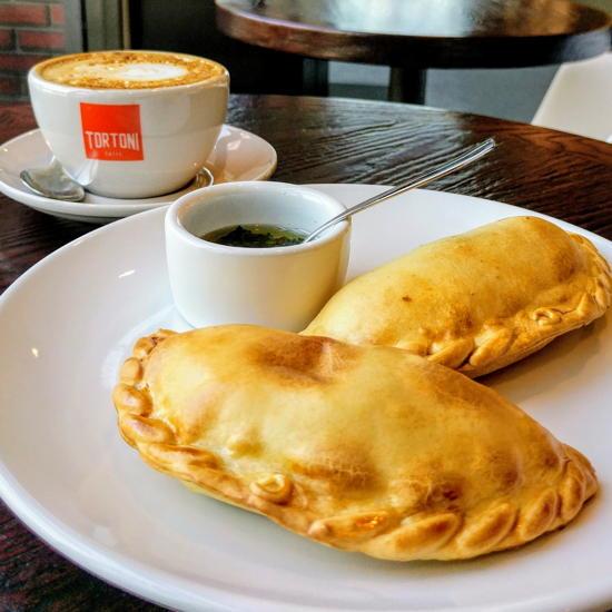 Tortoni Caffé - Empanadas with chimichurri (Foodzooka)